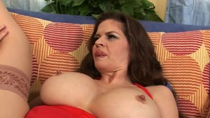 Huge boobs June Summers blowjobs on the couch