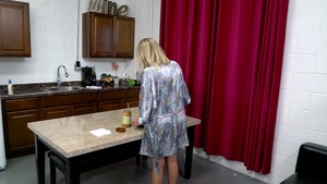 Busty blonde handjob in the kitchen