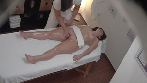 Erotic babe massage on the table